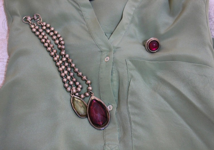 green shirt and crystal stones necklace