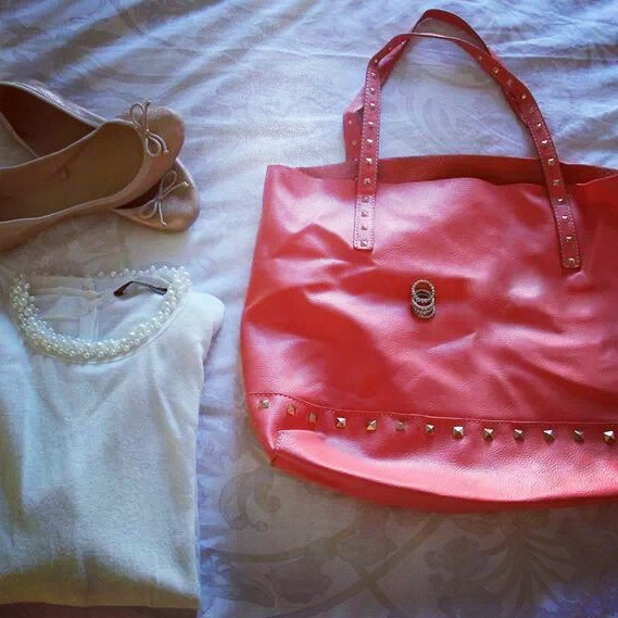 pearl white sweater and coral stud bag